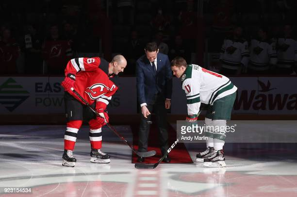 Former Devils forward Patrik Elias drops the ceremonial puck with Andy Greene of the New Jersey Devils and Zach Parise of the Minnesota Wild at...