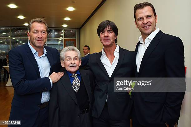 Former DFB physiotherapist Adolf Katzenmeier poses with Andreas Koepke, Joachim Loew and Oliver Bierhoff during a reception for his 80th birthday at...