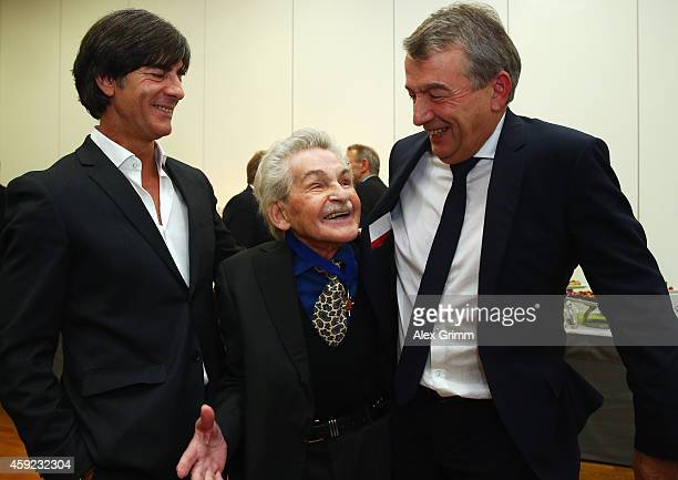 Former DFB physiotherapist Adolf Katzenmeier poses with DFB President Wolfgang Niersbach and Joachim Loew during a reception for his 80th birthday at...