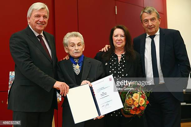 Former DFB physiotherapist Adolf Katzenmeier poses with his wife Silvia and DFB President Wolfgang Niersbach after receiving the Hession Order of...