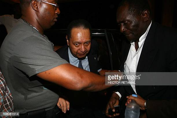 Former dictator JeanClaude Baby Doc Duvalier is escorted upon arrival in a surprise return to Haiti on Sunday January 16 in the midst of a political...