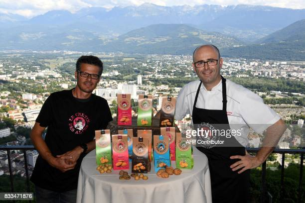 Former director of Isere Tourism communication Yann d'Ascoli and maitre-restaurateur Laurent Gras pose with products of 'Le Cretin des Alpes' on...
