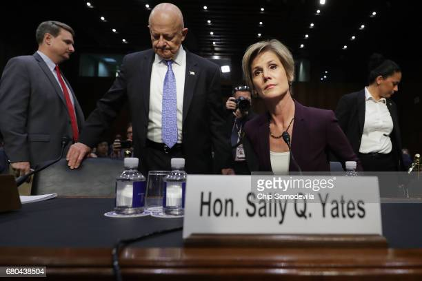 Former Director of National Intelligence James Clapper and former acting US Attorney General Sally Yates arrive before testifying to the Senate...