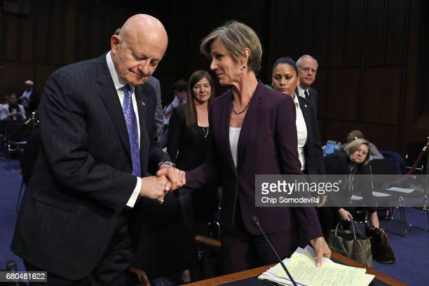 Former Director of National Intelligence James Clapper and former acting US Attorney General Sally Yates shake hands after testifying before the...