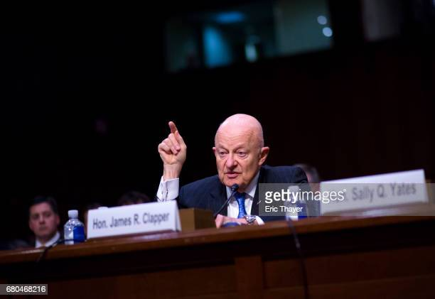 Former Director of National Intelligence James Clapper testifies before the Senate Judicary Committee's Subcommittee on Crime and Terrorism in the...