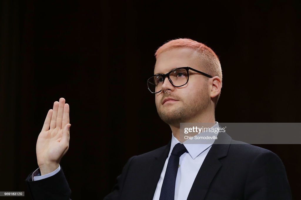 Former director of research for Cambridge Analytica Christopher Wylie is sworn in before testifying to the Senate Judiciary Committee in the Dirksen Senate Office Building on Capitol Hill May 16, 2018 in Washington, DC. As a whistleblower, Wylie was quizzed by the committee about his former employer's work with Russia and the Trump campaign. 'Social platforms are no longer safe,' he said.