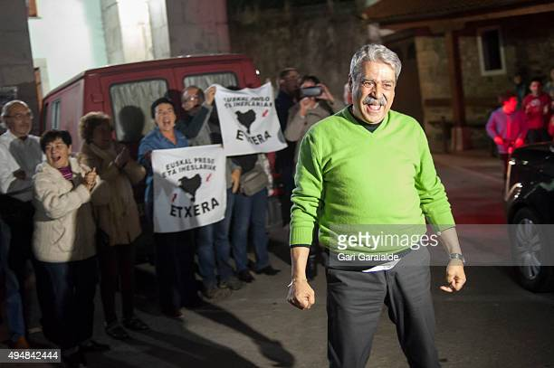 Former director of the banned newspapper 'Egin', Javier Salutregi greets friends in the town of Ea after he was released from prison on October 29,...