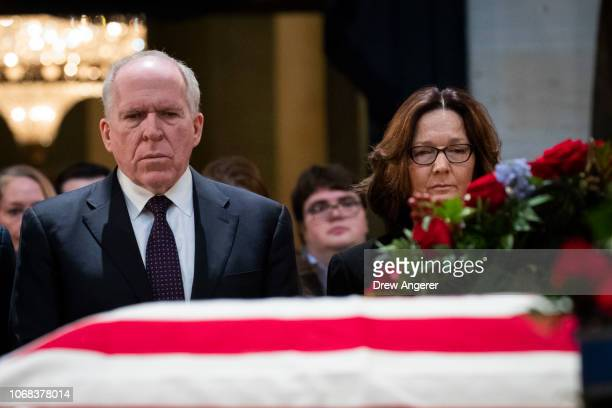 Former Director of the CIA John Brennan and current Director of the CIA Gina Haspel pay their respects at the casket of the late former President...