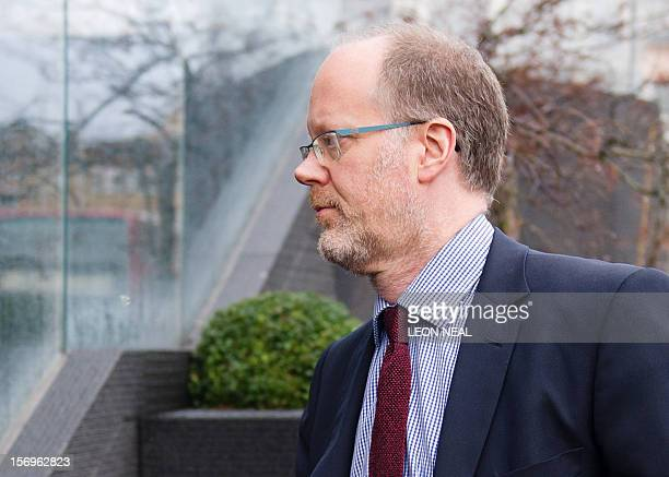 Former directorgeneral of the BBC George Entwistle arrives at the building housing a London solicitors office in central London on November 26 the...