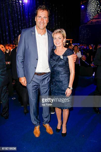Former discus thrower Lars Riedel and german national woman football team trainer Silvia Neid during the Goldene Henne after show party on October 28...