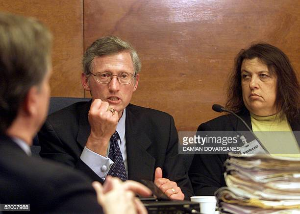 Former district attorney Stephen Kay shows how Leslie Van Houten held a knife as he addresses members of the Board of Prison Terms commissioners...