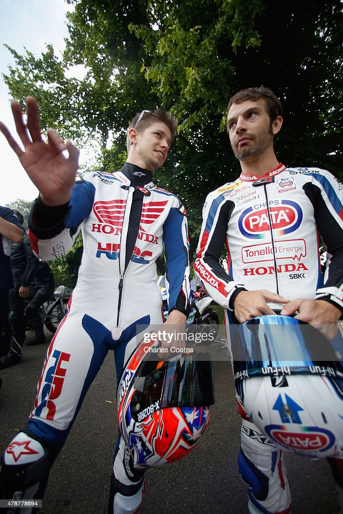 Former double World Moto GP Champion Casey Stoner chats with current World Superbike champion Sylvain Guintoli at Goodwood on June 27, 2015 in Chichester, England.