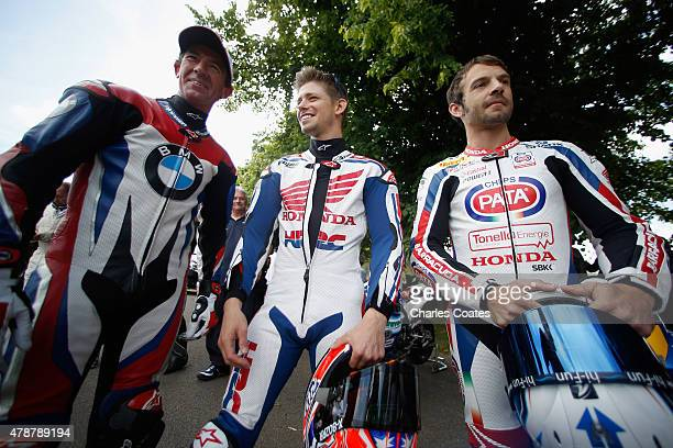 Former double World Moto GP Champion Casey Stoner chats with current World Superbike champion Sylvain Guintoli and former Superbike rider Troy Corser...