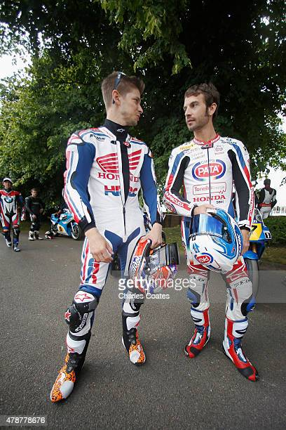 Former double World Motorcycle Champion Casey Stoner chats with current World Superbike champion Sylvain Guintoli at Goodwood on June 27 2015 in...