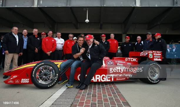 Former Driver Alex Zanardi poses with team owner Chip Ganassi during a presentation of Zanardi's 1998 Championship winning Target Honda Reynard...