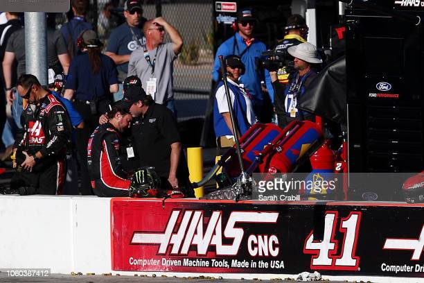 Former driver and coowner of StewartHaas Racing Tony Stewart consoles Kurt Busch driver of the Haas Automation/Monster Energy Ford after an ontrack...
