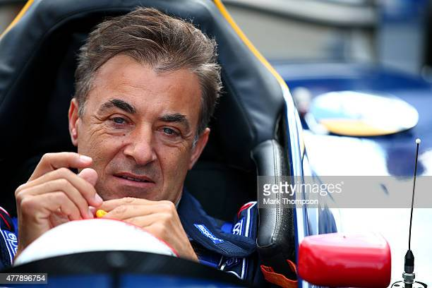 Former driver Jean Alesi sits in a car after qualifying for the Formula One Grand Prix of Austria at Red Bull Ring on June 20 2015 in Spielberg...
