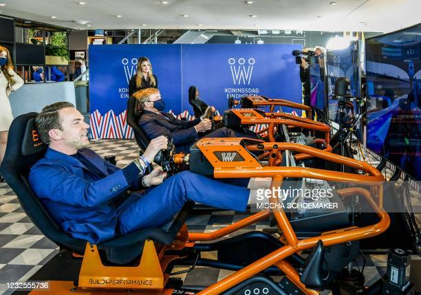 Former driver Robert Doornbos rides an E-Race together with King Willem-Alexander on King's Day on the High Tech Campus in Eindhoven, on April 27,...