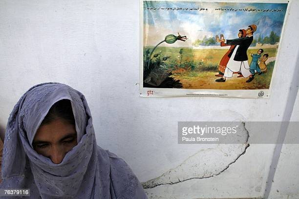 A former drug addict stands near an anti drug poster during her month long detox program at the Sanga Amaj Drug Treatment Center August 28 2007 in...