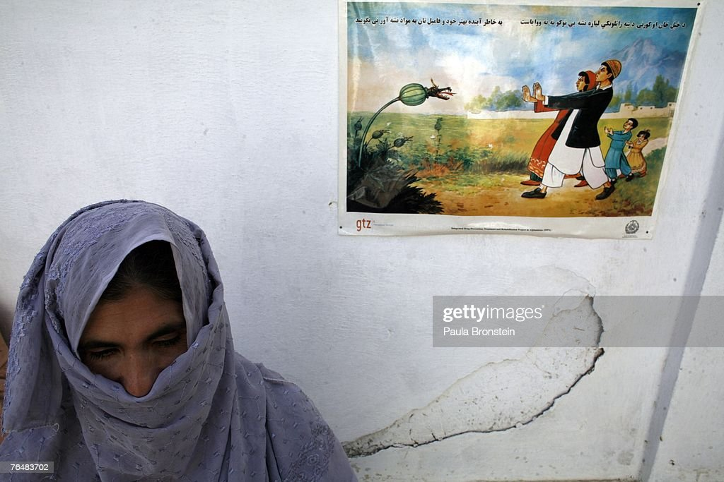 A former drug addict stands near an anti drug poster during her month long detox program at the Sanga Amaj Drug Treatment Center August 28, 2007 in Kabul, Afghanistan. The Sanga Amaj center is the first women's only drug treatment facility in the country, opening two months ago. Farmers in the Taliban-held areas of the south continue to grow opium. Although there are around 35,000 NATO troops in Afghanistan, the drug trade has increased, with Afghanistan producing 95 percent of the world's poppies. According to the UN Office on Drugs and Crime (UNODC), the opium production in 2006 increased 57 percent from 2005, with an additional 15% jump in 2007 despite a $600 million counter narcotics effort by the U.S.