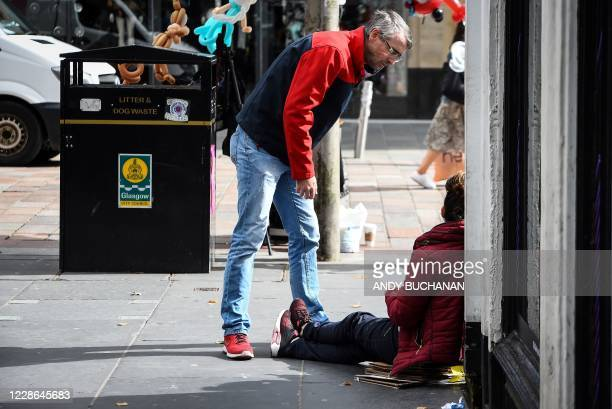 """Former drug user-turned-drug policy campaigner Peter Krykant distributes flyers to addicts and homeless people, promoting his """"Safe Consumption"""" van,..."""