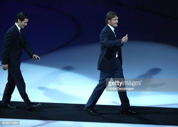 Former Ducks players Paul Kariya and and Teemu Selanne walk off the ice after a pregame ceremony honoring Kariya and Selanne for their induction into...