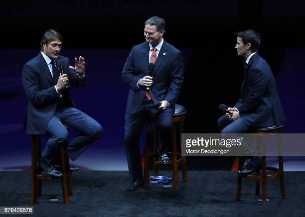 Former Ducks players Teemu Selanne and Paul Kariya and Ducks commentator Brian Hayward speak at center ice about Selanne's and Karyiya's induction...