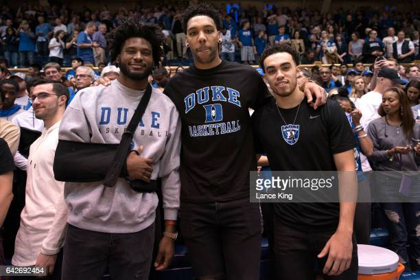 Former Duke basketball players Justise Winslow Jahlil Okafor and Tyus Jones pose for a photo following the game between the Duke Blue Devils and the...