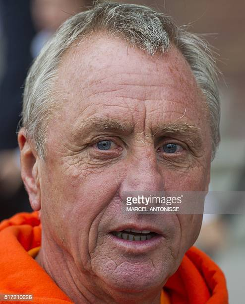 Former Dutch football player Johan Cruyff who currently works as a team coach talks as he prepares to take part in a game of wheelchair basketball on...