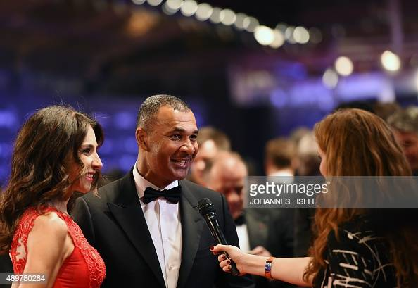 Former Dutch football star Ruud Gullit and his wife