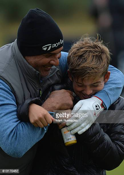Former Dutch Footballer Ruud Gullit shares a joke with Charley Redknapp, son of Former England Footballer Jamie Redknapp at the 8th hole as they...