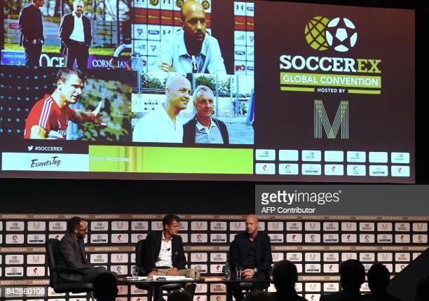 Former Dutch international footballer and comanager of Cruyff Football Wim Jonk listens as Maccabi Tel Aviv's Dutch Manager Jordi Cruyff speaks...