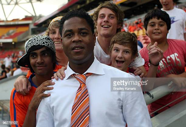 Former Dutch international player Patrick Kluivert poses with fans before the round 25 ALeague match between the Brisbane Roar and Sydney FC at...