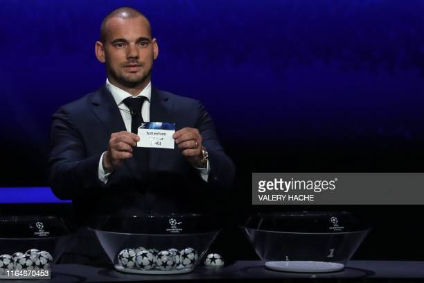 Former Dutch international Wesley Sneijder holds the slip of Tottenham Hotspur during the UEFA Champions League football group stage draw ceremony in...