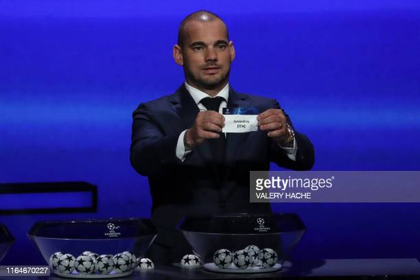 Former Dutch international Wesley Sneijder holds the slip of Juventus Turin during the UEFA Champions League football group stage draw ceremony in...