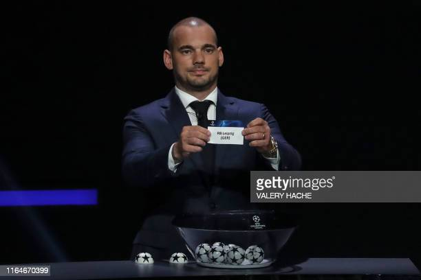 Former Dutch international Wesley Sneijder holds the slip of RB Leipzig during the UEFA Champions League football group stage draw ceremony in Monaco...