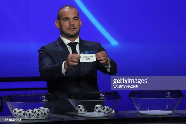 Former Dutch international Wesley Sneijder holds the slip of Real Madrid FC during the UEFA Champions League football group stage draw ceremony in...