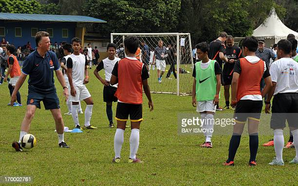 Former Dutch national football team coach Louis van Gaal gives instructions to the students during a coaching clinic session in Jakarta on June 6...