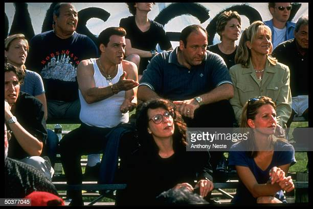 Former E Street Band guitarist actor Stevie Van Zandt actor James Gandolfini chatting at a sporting event in a scene from the HBO crime series The...