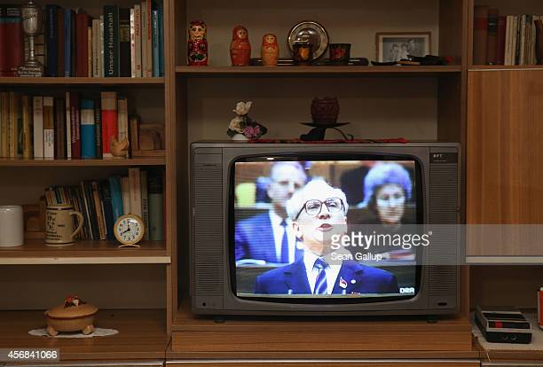 Former East German communist leader Erich Honecker delivers a speech at a congress of the East German communist party on a television in a...