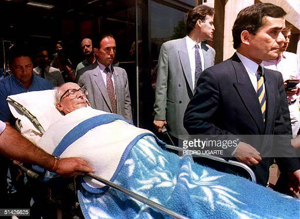Former East German leader Erich Honecker leaves the Las Condes Clinic in Santiago Chile 11 December 1993 Honecker in exile in Chile since January was...