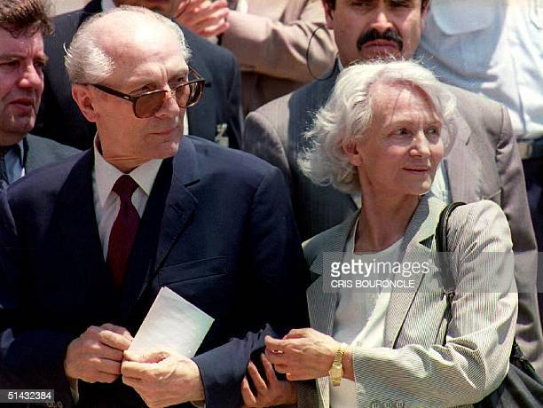 Former East German President Erich Honecker is reunited with his wife Margot upon his arrival at Santiago Airport 14 January 1993 in Santiago Chile...