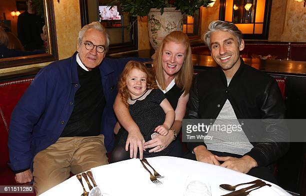 Former EastEnders actor Larry Lamb and TV presenter son George Lamb pose for a photo with Saoirse Henderson a patient at Alder Hey Hospital and her...
