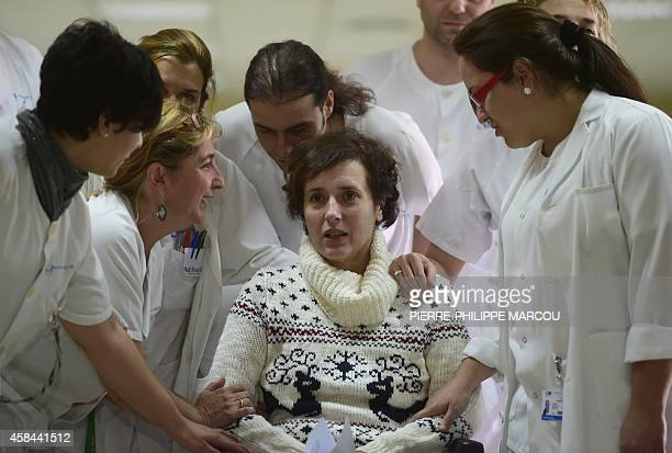 Former ebola patient Spanish nurse Teresa Romero poses with medical staff before a press conference at Carlos III Hospital in Madrid on November 5...