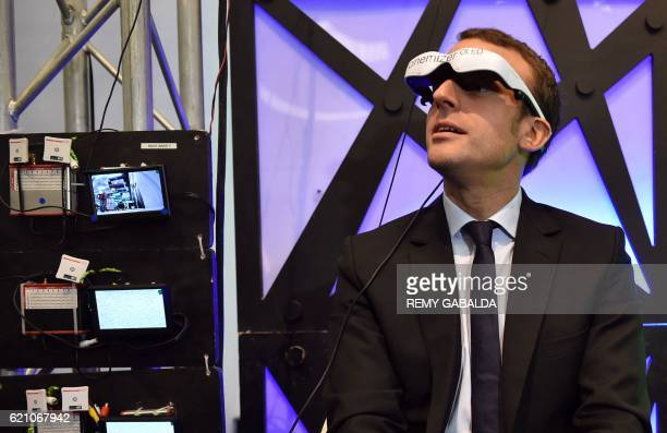 Former Economy minister and head of the En marche political movement Emmanuel Macron visits the Futurapolis high tech fair in Toulouse on November 4...
