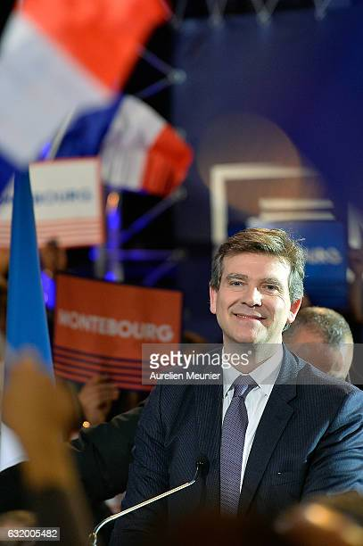 Former Economy Minister and LeftWing Primaries Candidate Arnaud Montebourg sings the French National Anthem waves at the crowd as he arrives for his...