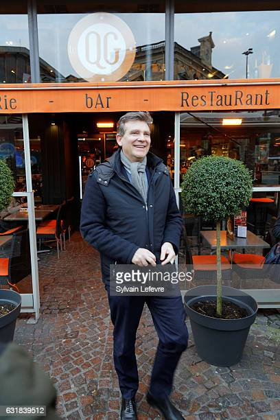 Former Economy Minister Arnaud Montebourg who is a candidate for France's leftwing primaries walks the downtown with the media ahead of the 2017...