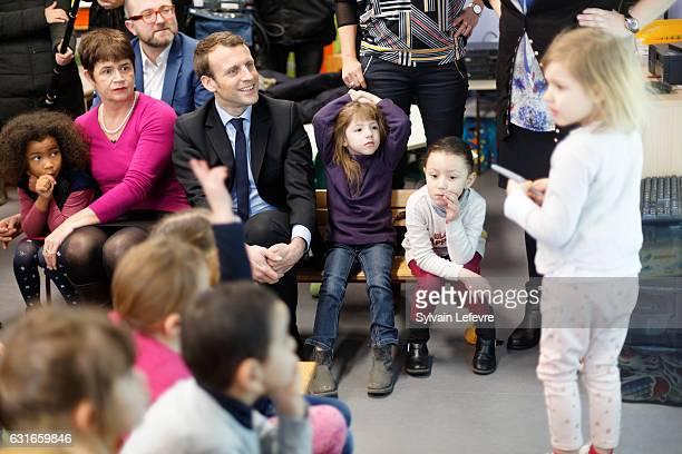 Former Economy Minister Emmanuel Macron visits an infant school during his campaign for next presidential elections on January 14, 2017 in Lille,...
