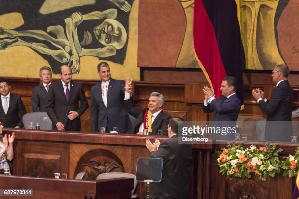 Former Ecuadorian president Rafael Correa center left raises the hand of Lenin Moreno Ecuador's president center during the presidential inauguration...