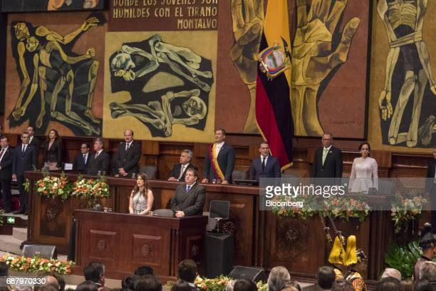 Former Ecuadorian president Rafael Correa center right speaks as Lenin Moreno Ecuador's presidentelect center left listens during the presidential...